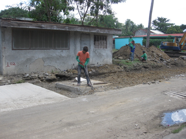 men working on the road